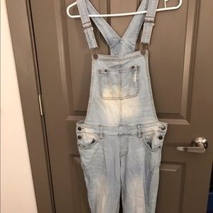 Light-wash distressed denim overalls